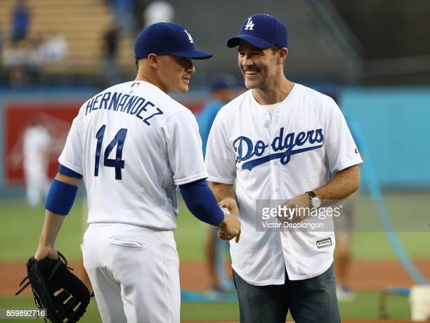Actor James Van Der Beek gets a baseball from Enrique 'Kike' Hernandez of the Los Angeles Dodgers after Van Der Beek threw out the ceremonial first...