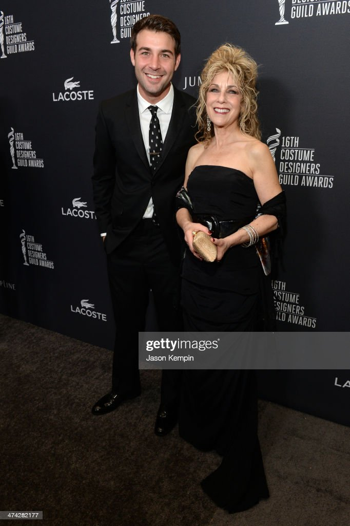 Actor James Wolk (L) and Edie Wolk attend the 16th Costume Designers Guild Awards with presenting sponsor Lacoste at The Beverly Hilton Hotel on February 22, 2014 in Beverly Hills, California.