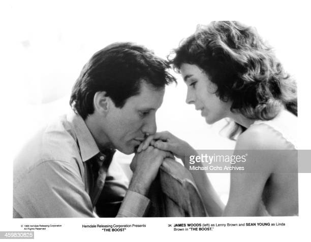 """Actor James Woods and actress Sean Young on set of the movie """"The Boost"""" , circa 1988."""