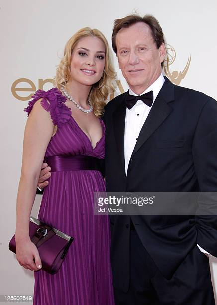 Actor James Woods and Ashley Madison arrive to the 63rd Primetime Emmy Awards at the Nokia Theatre LA Live on September 18 2011 in Los Angeles United...