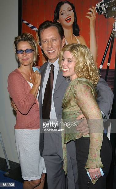 Actor James Woods poses with his exwife Kathryn Morrison and his girlfriend at the SKYY Vodka Short Film Awards on June 27 2002 in Los Angeles...
