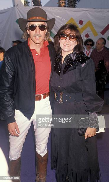 Actor Jameson Parker and wife Bonnie Parker attend 37th Annual SHARE Boomtown Party on May 19 1990 at the Santa Monica Civic Auditorium in Santa...