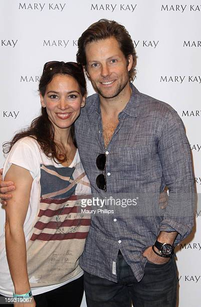 Actor Jamie Bamber and Kerry Norton pose with Mary Kay at Kari Feinstein's PreGolden Globes Style Lounge at the W Hollywood on January 11 2013 in...