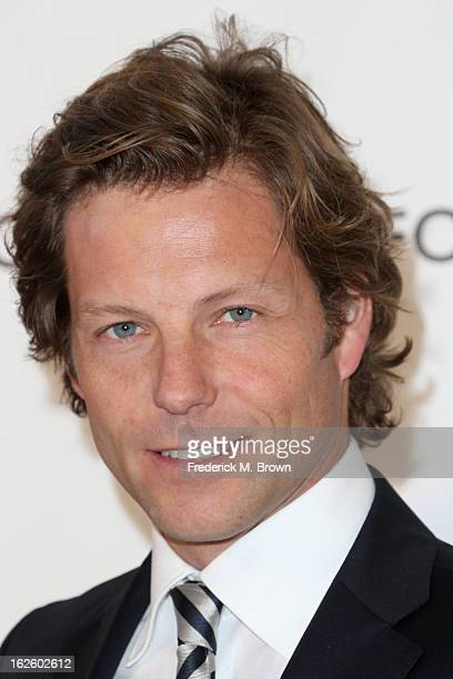 Actor Jamie Bamber arrives at the 21st Annual Elton John AIDS Foundation's Oscar Viewing Party on February 24 2013 in Los Angeles California