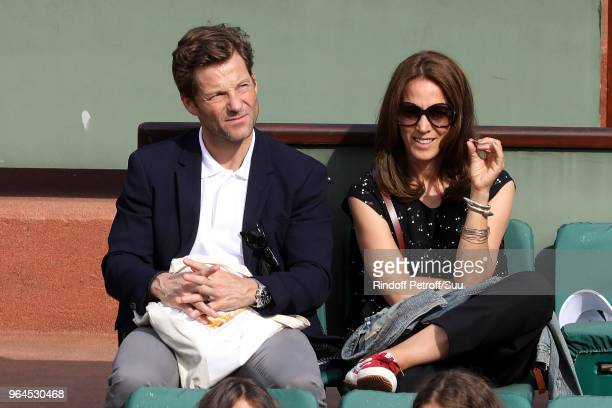Actor Jamie Bamber nad his wife Kerry Norton attend the 2018 French Open Day Five at Roland Garros on May 31 2018 in Paris France