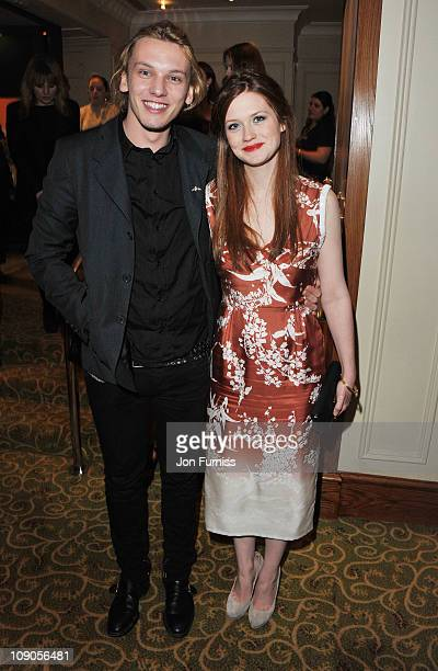 Actor Jamie Campbell Bower and actress Bonnie Wright attend the official after party for Orange British Academy Film Awards at Grosvenor House on...