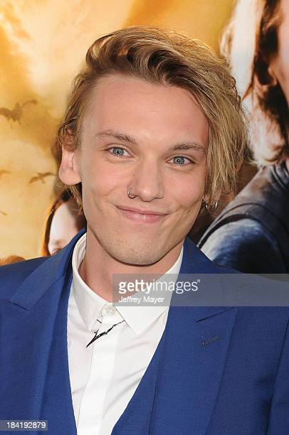 Actor Jamie Campbell Bower arrives at the Los Angeles premiere of 'The Mortal Instruments City Of Bones' at ArcLight Cinemas Cinerama Dome on August...