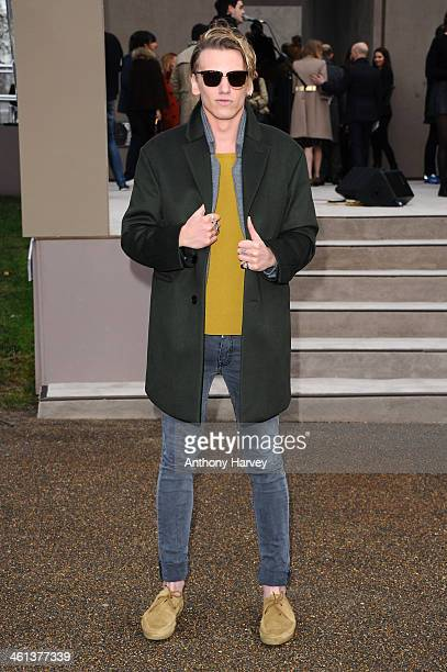 Actor Jamie Campbell Bower attends the Burberry Prorsum show during The London Collections Men Autumn/Winter 2014 on January 8 2014 in London England