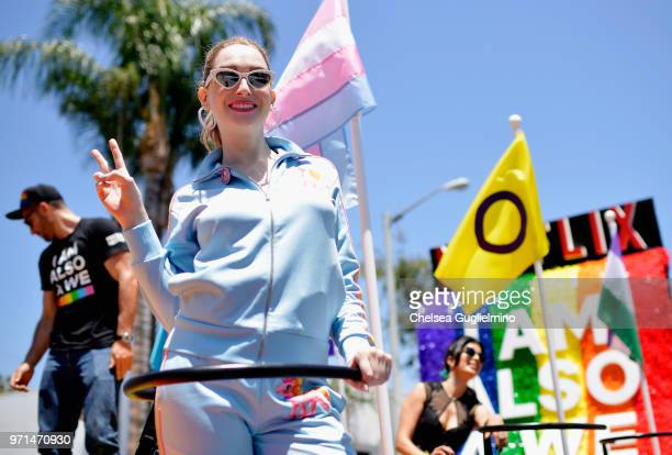 Actor Jamie Clayton poses on the Netflix original series 'Sense8' float at the LA Pride Parade 2018 on June 10 2018 in West Hollywood California