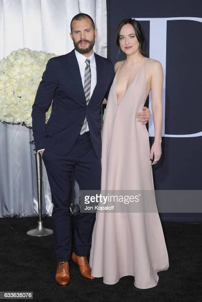 Actor Jamie Dornan and actress Dakota Johnson arrive at the Los Angeles premiere 'Fifty Shades Darker' at The Theatre at Ace Hotel on February 2 2017...