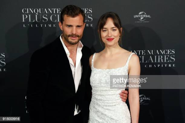 Actor Jamie Dornan and actress Dakota Johnson pose as they arrive to attend 'Fifty Shades Freed 50 Nuances Plus Claires' Premiere at Salle Pleyel in...
