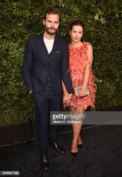 Actor Jamie Dornan and Amelia Warner attend Charles Finch and Chanel's PreOscar Awards Dinner at Madeo Restaurant on March 3 2018 in Los Angeles...