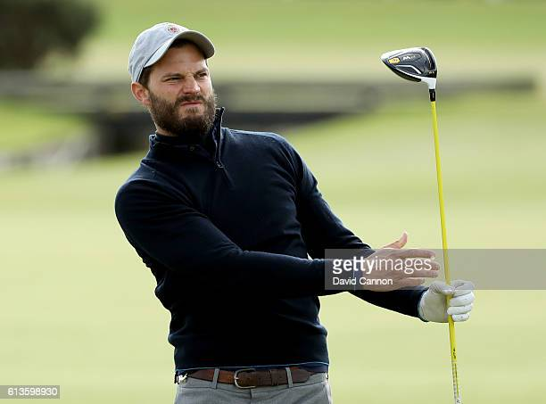 Actor Jamie Dornan drives off the second tee during the final round of the Alfred Dunhill Links Championship at The Old Course on October 9 2016 in...