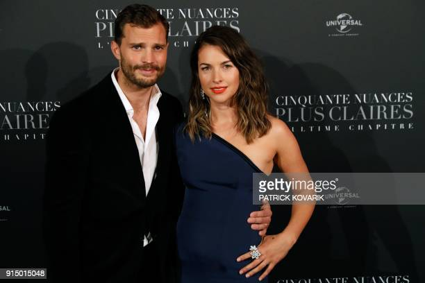Actor Jamie Dornan poses with his wife Amelia Warner as they arrive to attend 'Fifty Shades Freed 50 Nuances Plus Claires' Premiere at Salle Pleyel...