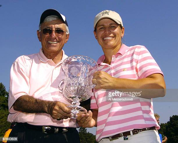 Actor Jamie Farr and winner Heather Bowie hold the champion's trophy after the final round of the Jamie Farr Owens Corning Classic July 10 2005 Bowie...