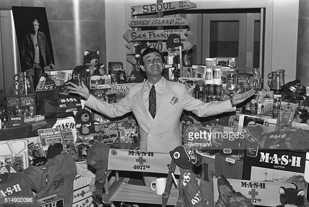 Actor Jamie Farr who played Klinger in the TV show MASH poses with some of the products spun off from the popular movie and TV show Five hundred...