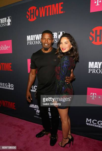 Actor Jamie Foxx and Actress Olivia Munn arrived on TMobile's magenta carpet duirng the Showtime WME IME and Mayweather Promotions VIP PreFight Party...