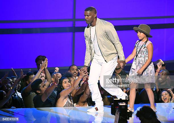 Actor Jamie Foxx and daughter Annalise Bishop walk onstage during the 2016 BET Awards at the Microsoft Theater on June 26 2016 in Los Angeles...