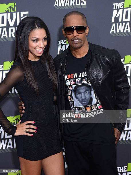 Actor Jamie Foxx and daughter Corinne Bishop arrive at the 2013 MTV Movie Awards at Sony Pictures Studios on April 14 2013 in Culver City California