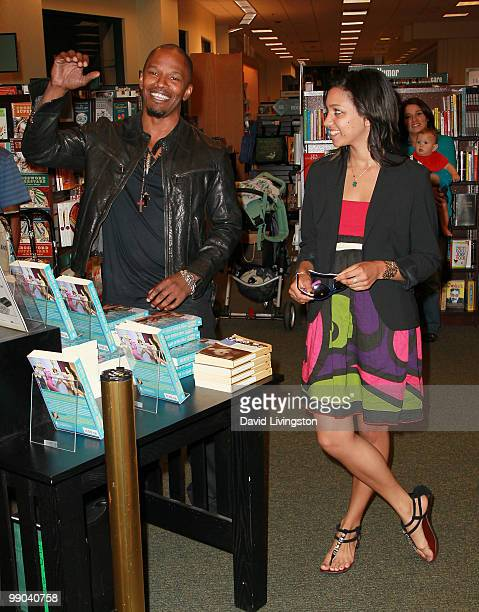 Actor Jamie Foxx and daughter Corinne Foxx attend a signing for Victoria Rowell's book Secrets of a Soap Opera Diva at Barnes Noble Booksellers at...