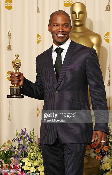 "Actor Jamie Foxx and his award for ""Best Actor in a Leading Role"" for ""Ray"" poses backstage during the 77th Annual Academy Awards on February 27,..."