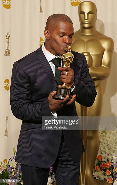 Actor Jamie Foxx and his award for 'Best Actor in a Leading Role' for 'Ray' poses backstage during the 77th Annual Academy Awards on February 27 2005...