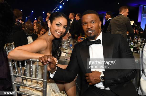 US actor Jamie Foxx and his daughter Corinne Foxx during the 26th Annual Screen Actors Guild Awards show at the Shrine Auditorium in Los Angeles on...
