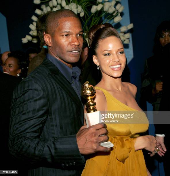 Actor Jamie Foxx and his girlfriend Leila Arcieri pose after he won the award for Best actor in a Leading Role Musical or Comedy at the 62nd Annual...