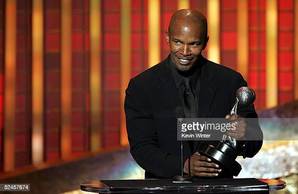 Actor Jamie Foxx appears on stage with his award at the 36th NAACP Image Awards at the Dorothy Chandler Pavilion on March 19 2005 in Los Angeles...