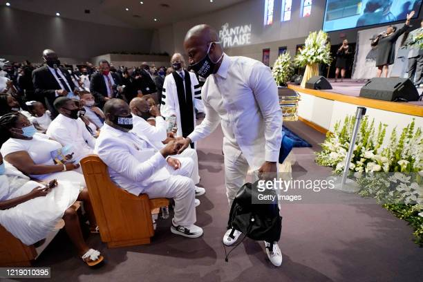 Actor Jamie Foxx greets the family at the funeral service for George Floyd in the chapel at the Fountain of Praise church June 9, 2020 in Houston,...