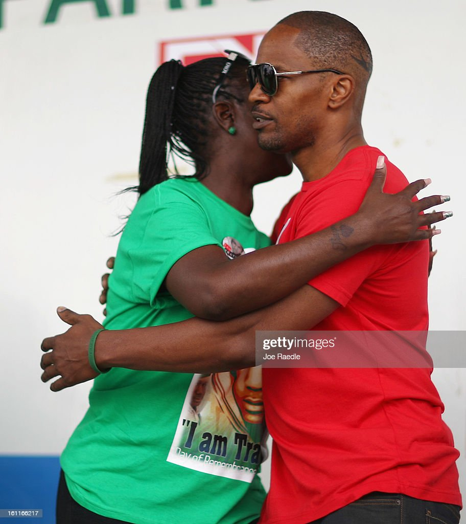 Actor Jamie Foxx hugs Sybrina Fulton during the 'March for Peace' at Ives Estate Park in honor of her late son, Trayvon Martin, on February 9, 2013 in Miami, Florida. Trayvon Martin was killed by George Zimmerman on February 26, 2012 while Zimmerman was on neighborhood watch patrol in the gated community of The Retreat at Twin Lakes in Sanford, Florida.