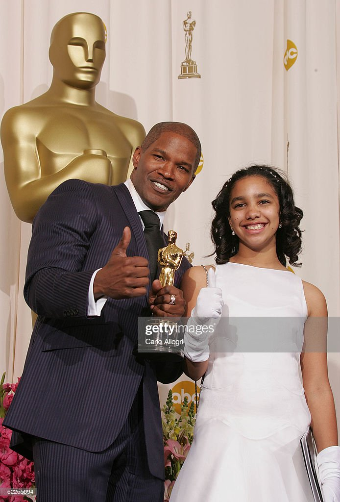 Actor Jamie Foxx pose with his 'Best Actor in a Leading Role' award for 'Ray' with his daughter Corrine Marie backstage during the 77th Annual Academy Awards on February 27, 2005 at the Kodak Theater in Hollywood, California.