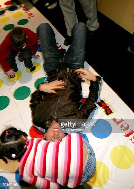 Actor Jamie Kennedy falls over playing Twister as he takes part in a 'Son of the Mask' event at The Children's Museum of Manhattan on February 14...
