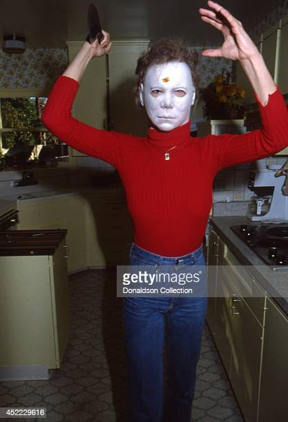 Actor Jamie Lee Curtis poses for a portrait session wearing a scary mask and holding a kitchen knife in 1979 in Los Angeles California