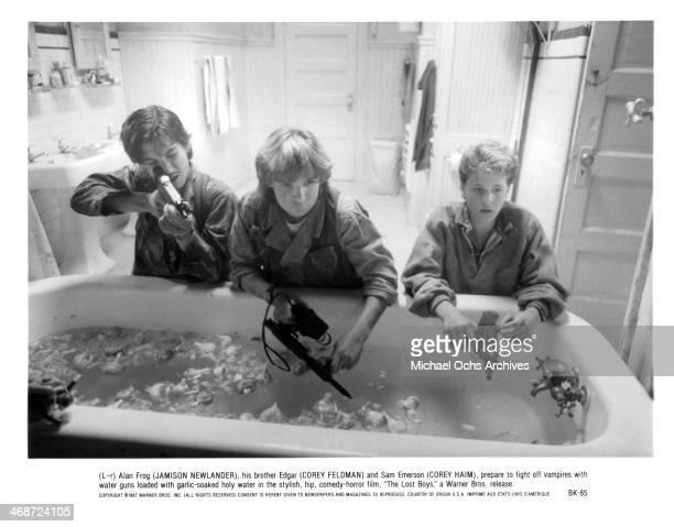 Actor Jamison Newlander Corey Feldman and actor Corey Haim on set of the Warner Bros movie 'The Lost Boys ' circa 1987