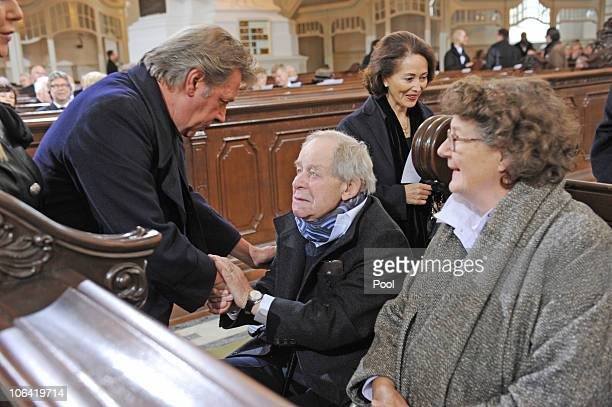 Actor Jan Fedder shake hands with German writer Siegfried Lenz during the memorial service for Loki Schmidt wife of former German Chancellor Helmut...
