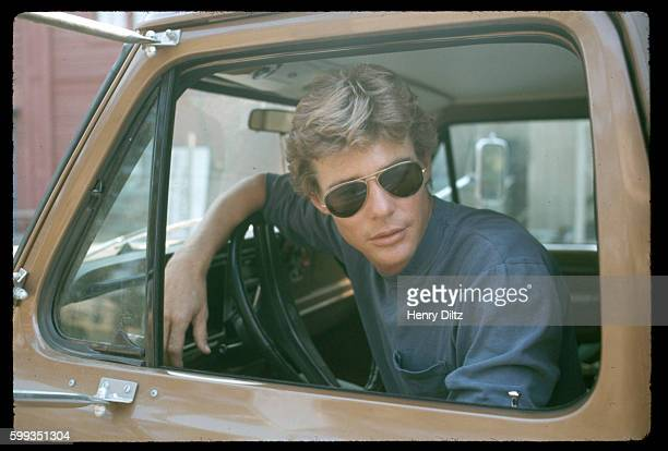Actor JanMichael Vincent driving a truck