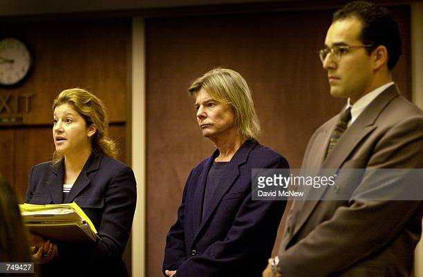 Actor JanMichael Vincent stands between his lawyer left and the prosecuting attorney at his probation violation hearing July 11 2000 Laguna Niguel CA...