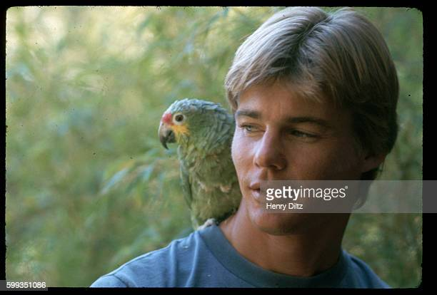 Actor JanMichael Vincent with a parrot on his shoulder