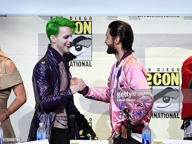 Actor Jared Leto greets a cosplayer as The Joker onstage at the Warner Bros 'Suicide Squad' Presentation during ComicCon International 2016 at San...