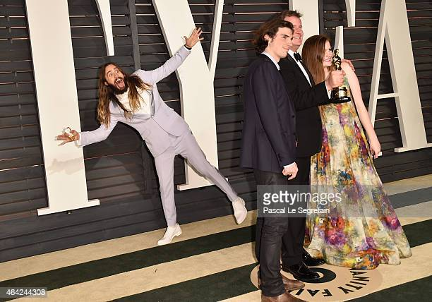 Actor Jared Leto photobombs producer James W Skotchdopole and guests at the 2015 Vanity Fair Oscar Party hosted by Graydon Carter at Wallis Annenberg...