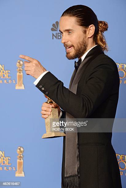 """Actor Jared Leto, winner of the Best Supporting Actor in a Motion Picture - Drama, Musical or Comedy award for """"Dallas Buyers Club,"""" poses in the..."""