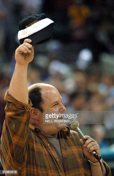 US actor Jason Alexander of television sitcom Seinfeld fame acknowledges the crowd as he sings the National Anthem prior to game six between the...