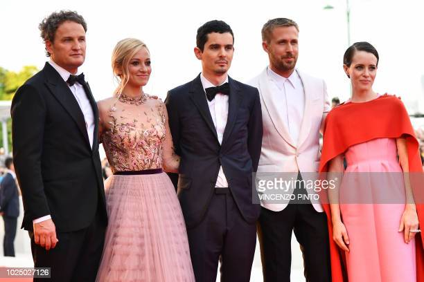 TOPSHOT Actor Jason Clarke actress Olivia Hamilton director Damien Chazelle actor Ryan Gosling and actress Claire Foy pose as they arrive for the...