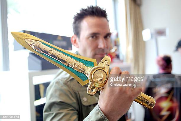 Actor Jason David Frank the original Green Mighty Morphin Power Ranger poses with Bandai's ComicCon Exclusive Limited Edition Legacy Dragon Dagger at...