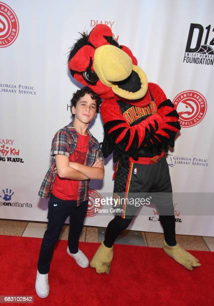 """Actor Jason Drucker and Harry The Hawk attend """"Diary Of A Wimpy Kid: The Long Haul"""" Atlanta screening hosted by Dwight Howard at Regal Atlantic..."""