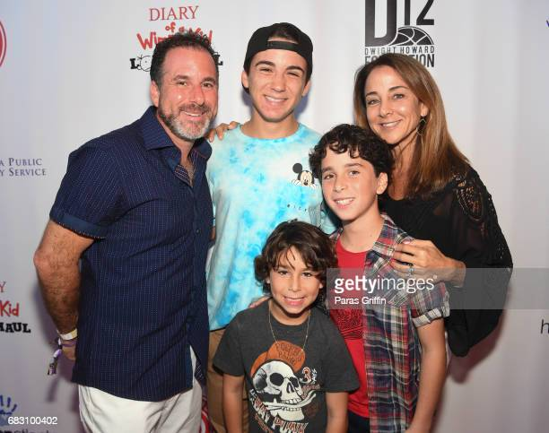 Actor Jason Drucker with family attend Diary Of A Wimpy Kid The Long Haul Atlanta Screening hosted by Dwight Howard at Regal Atlantic Station on May...