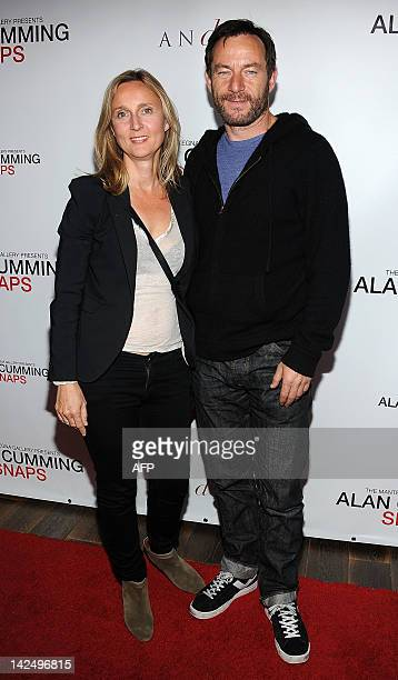 Actor Jason Isaacs and Emma Hewitt arrive at the reception celebrating the release of the limited edition fine art photography of Alan Cumming in Los...