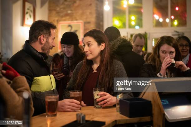 Actor, Jason Isaacs and Lib Dem MP, Luciana Berger enjoy some refereshments during a Liberal Democrat campaign event at The Bald Faced Stag Pub on...