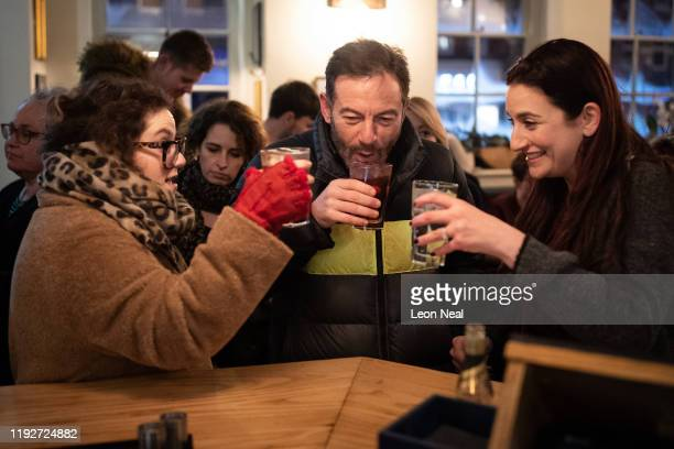 Actor, Jason Isaacs and Lib Dem MP, Luciana Berger enjoy some refreshments during a Liberal Democrat campaign event at The Bald Faced Stag Pub on...